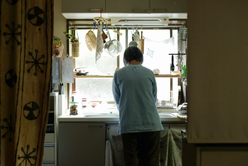 Mature woman working in kitchen,rear view