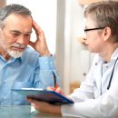 alexraths130300016.jpg - male patient tells the doctor about his health complaints
