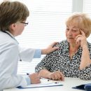 alexraths160700029.jpg - female doctor explaining diagnosis to her senior patient