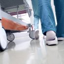sudok1141000130.jpg - medical staff moving patient through hospital corridor