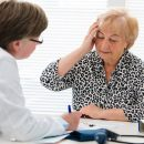 alexraths160700035.jpg - female senior patient tells the doctor about her health complaints