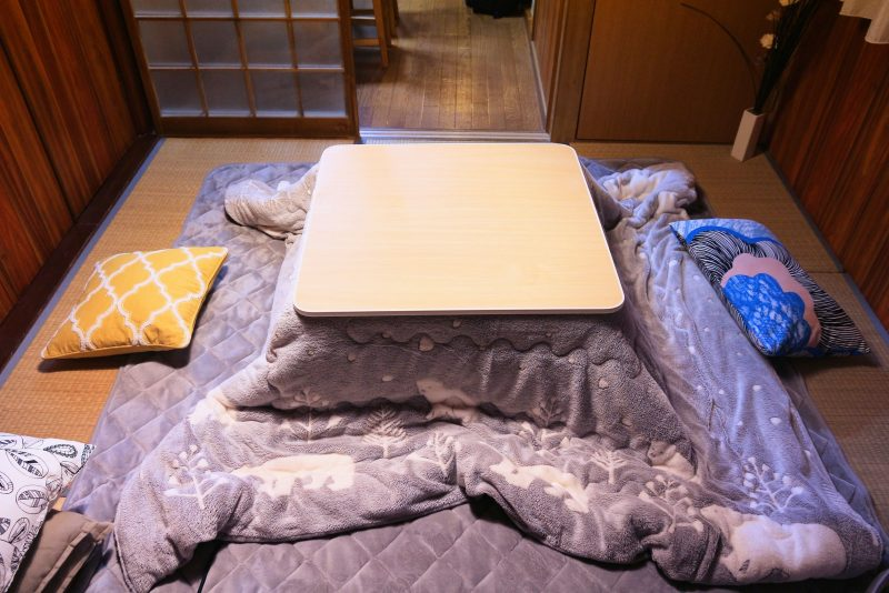 tupungato171000148.jpg - japanese living room with kotatsu - table with heating and attached blanket for winter warmth.
