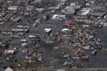 震災直後に空から見た被災地 市全体が冠水も屋上からSOS
