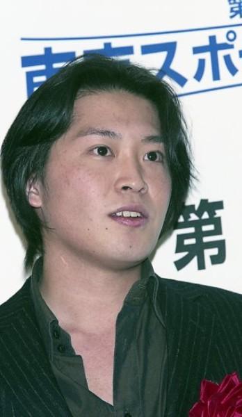三田 佳子