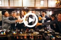 A group of Japanese people are having celebratory toast with beer in an Izakaya (Japanese style pub).