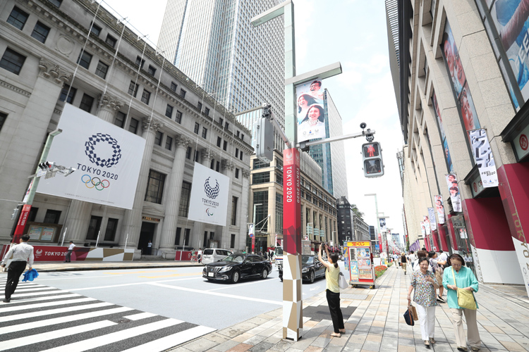 オリンピックムードが高まる東京都内だが…(時事通信フォト)