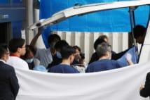 11月14日、青葉真司容疑者は京都市内の病院へ搬送された(時事通信フォト)